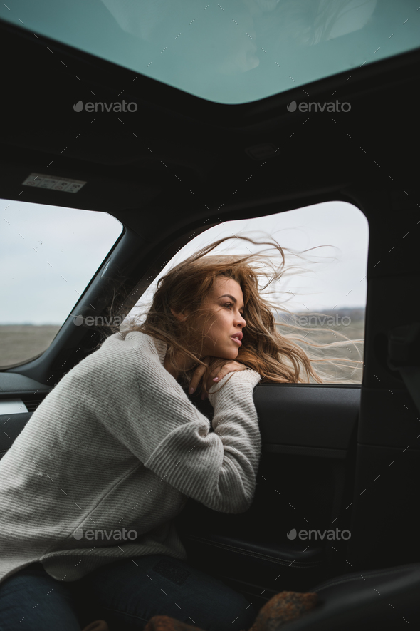wonderful chilling girl travelling in the car - Stock Photo - Images