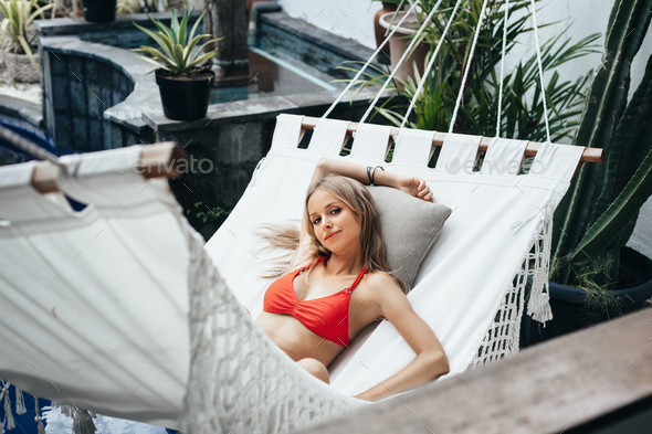 Woman laying down on white hammock - Stock Photo - Images