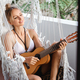 woman playing ukulele in hammock - PhotoDune Item for Sale