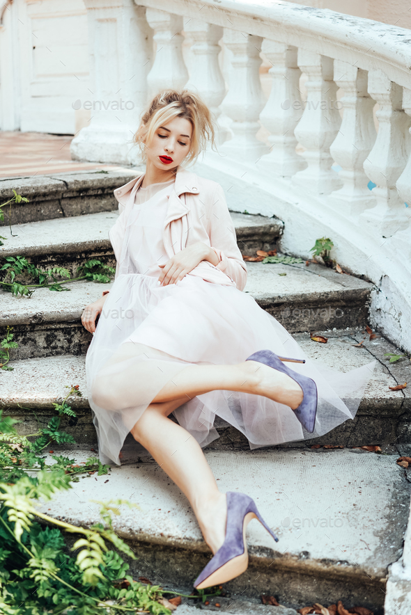 Girl is posing on the stone steps - Stock Photo - Images