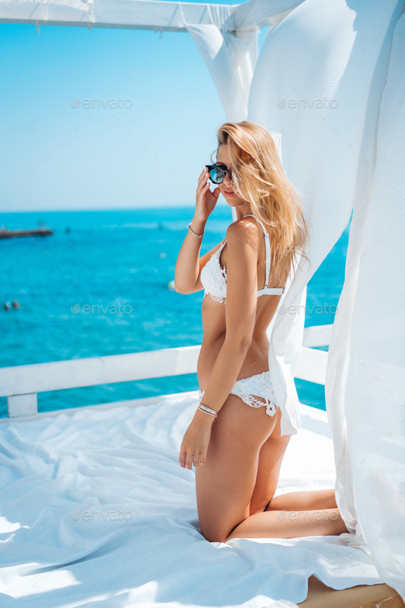 beautiful woman in white bikini - Stock Photo - Images