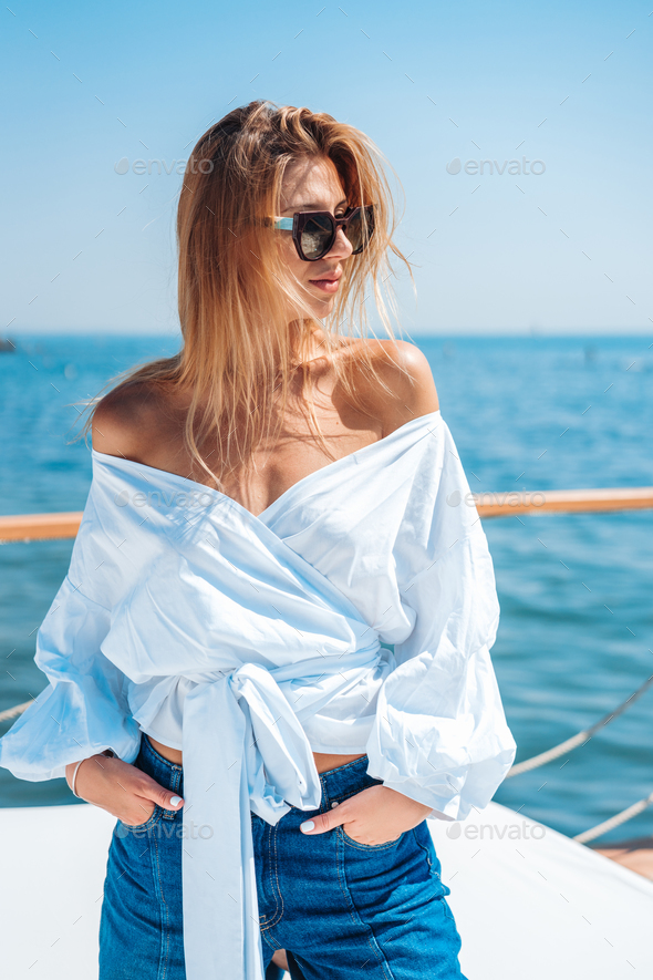 beautiful woman on a beach bed - Stock Photo - Images