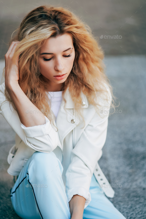 beautiful young girl posing at the camera - Stock Photo - Images
