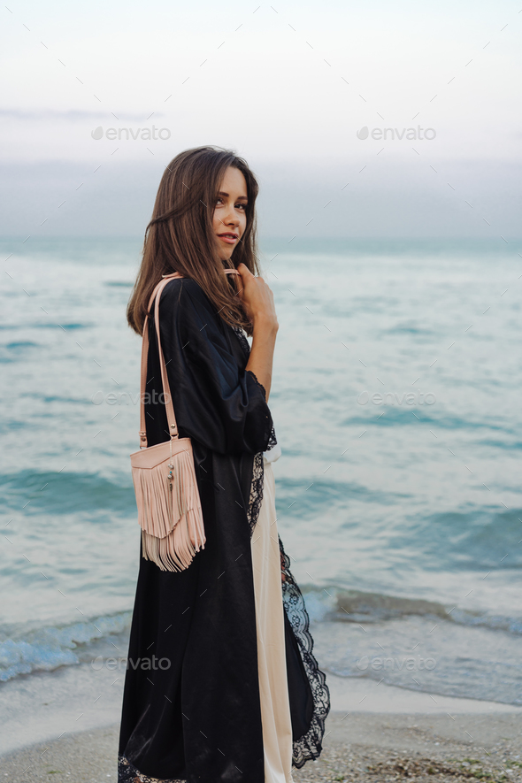 beautiful young girl with a handbag - Stock Photo - Images