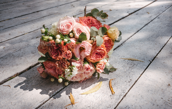 wedding bouquet on the wooden floor - Stock Photo - Images