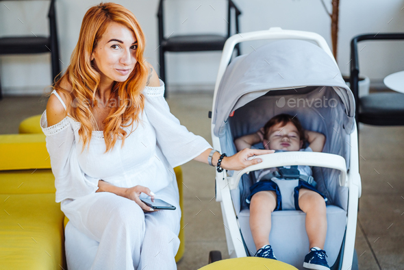 Mom and stroller with her baby - Stock Photo - Images