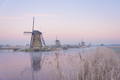 Pastel sunrise over windmills in winter - PhotoDune Item for Sale