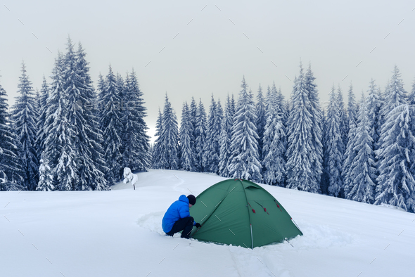Green tent in winter mountains - Stock Photo - Images