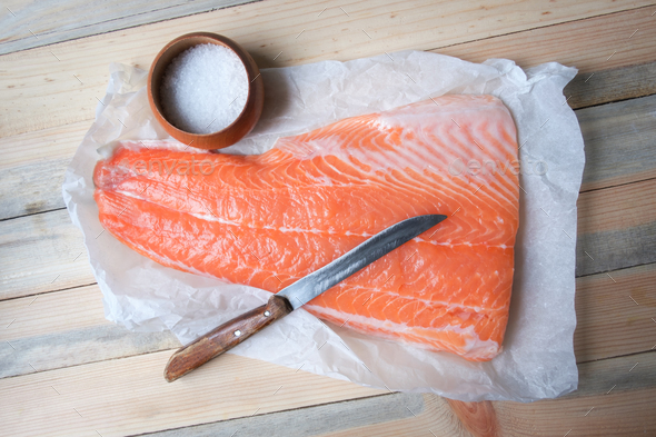 Fillet of salmon fish on wooden table - Stock Photo - Images