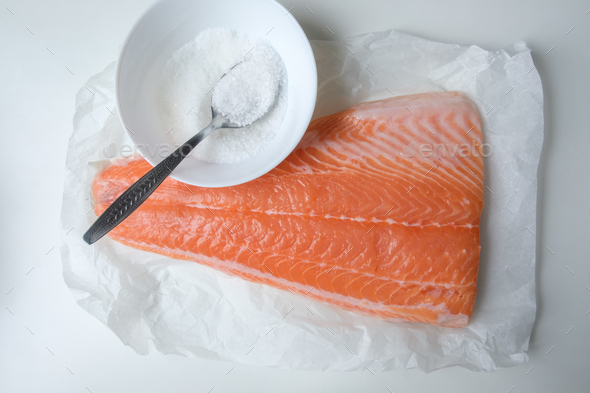 Fillet of salmon fish on white table - Stock Photo - Images