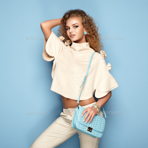 Fashion portrait of woman in summer outfit - Stock Photo - Images