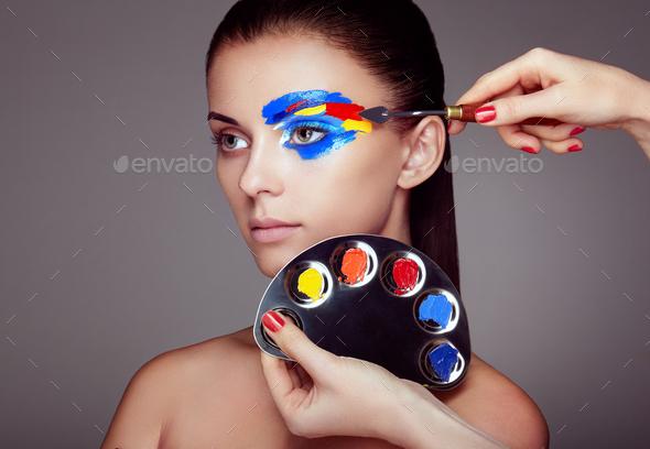 Makeup artist applies colorful makeup - Stock Photo - Images