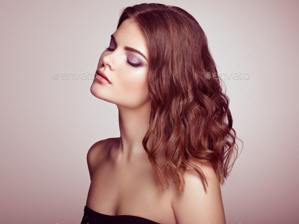 Brunette woman with long shiny wavy hair - Stock Photo - Images