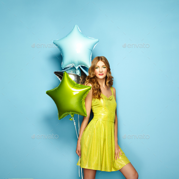 Beautiful young woman with colorful balloons - Stock Photo - Images