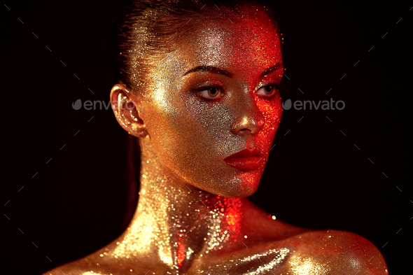 Portrait of beautiful woman with sparkles on her face - Stock Photo - Images
