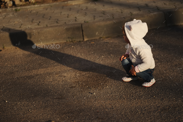little girl with shadow outdoors - Stock Photo - Images