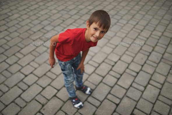 portrait of happy little boy outdoors - Stock Photo - Images
