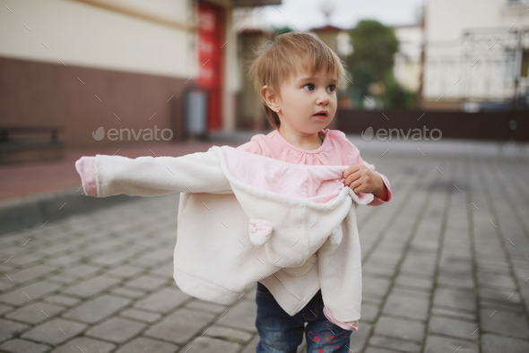 little girl tried to get dressed wrong way - Stock Photo - Images