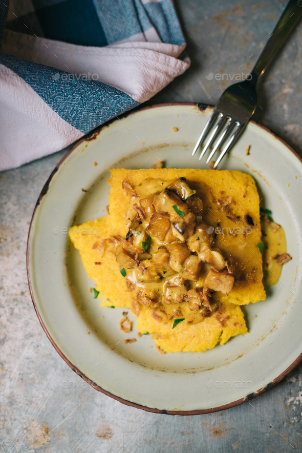 Polenta with butternut squash in cream - Stock Photo - Images
