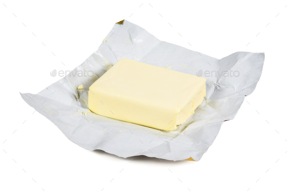 Piece of fresh butter on white background - Stock Photo - Images