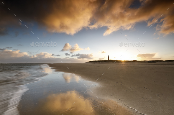 sunrise on North sea coast with lighthouse - Stock Photo - Images