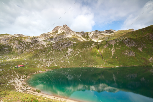 turquoise alpine lake in mountains - Stock Photo - Images