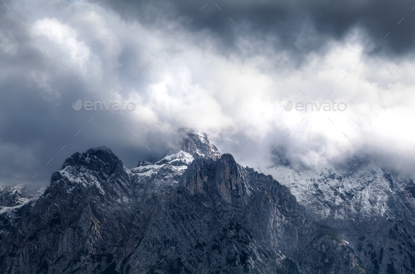dramatic storm clouds over mountain ridge - Stock Photo - Images