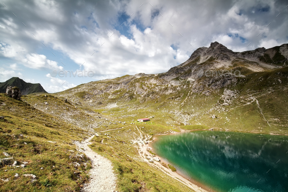 turquoise alpine lake in summer - Stock Photo - Images
