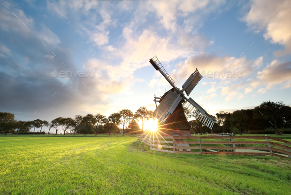 sunrise  behind beautiful Dutch windmill - Stock Photo - Images
