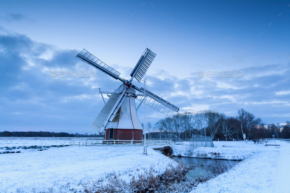 white windmill on snow - Stock Photo - Images