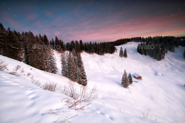 cabin in snowy mountains at sunrise - Stock Photo - Images