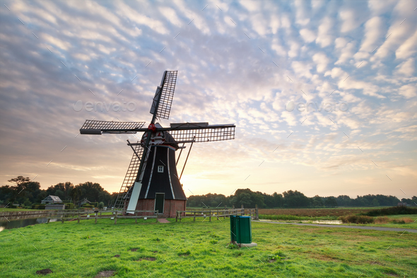 Dutch windmill during sunrise - Stock Photo - Images