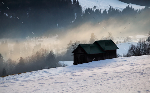 alpine winter countryside in evening sunlight - Stock Photo - Images