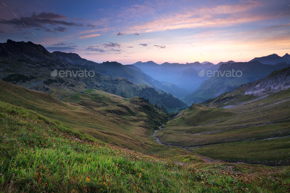 sunrise over beautiful mountains in summer - Stock Photo - Images