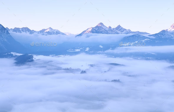 morning fog in winter Alps - Stock Photo - Images