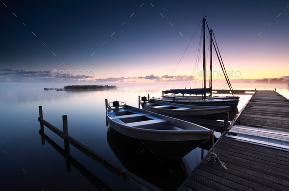 misty sunrise on lake harbor - Stock Photo - Images