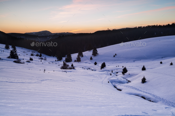 snowy mountains in dusk - Stock Photo - Images