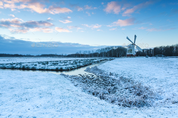 white windmill in winter morning - Stock Photo - Images