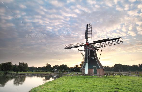 beautiful sunrise and Dutch windmill - Stock Photo - Images