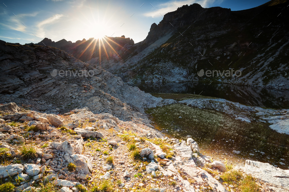 sunlight over alpine lake Laufbichelsee - Stock Photo - Images