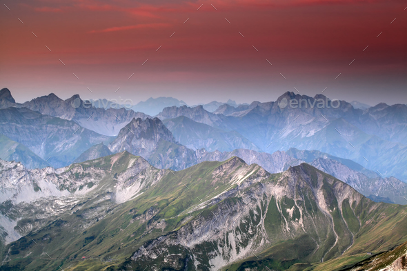 red sunrise over mountain peaks - Stock Photo - Images