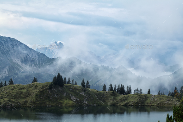 dense fog over mountains after rain - Stock Photo - Images