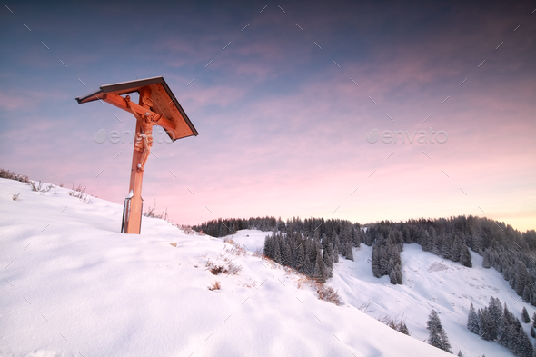 cross on top on mountain in winter - Stock Photo - Images