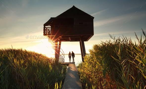 couple by wooden observing tower - Stock Photo - Images