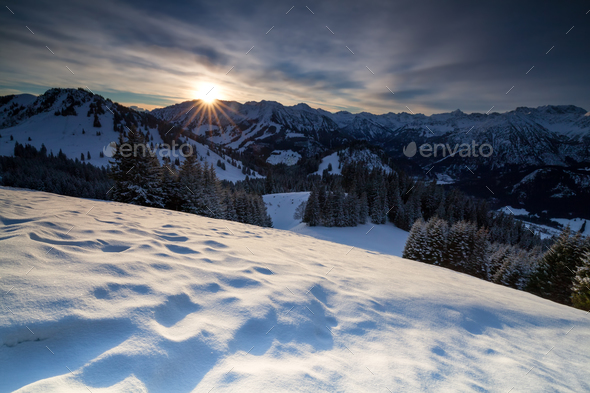sunrise over snowy mountains - Stock Photo - Images