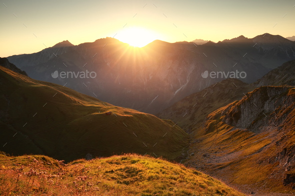 golden sunrise in mountains - Stock Photo - Images