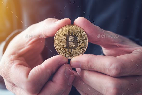 Man showing Bitcoin - Stock Photo - Images