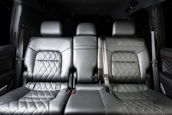 back seats of modern luxury car interior, black leather - Stock Photo - Images