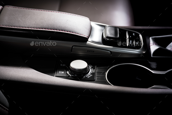 Media and navigation control buttons of a Modern car - Stock Photo - Images