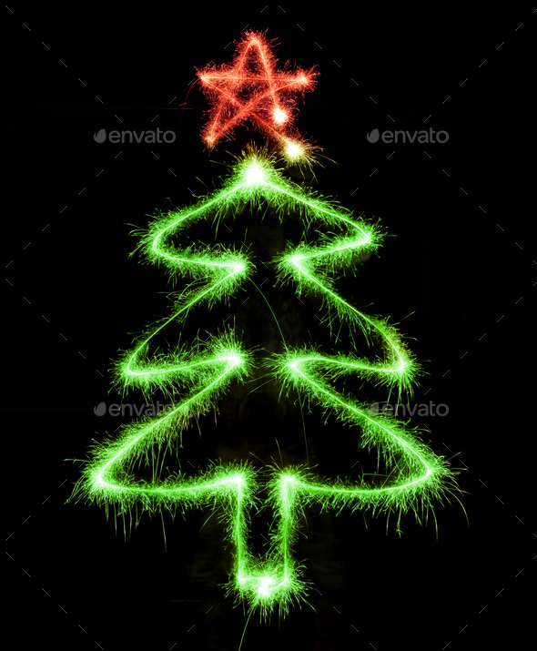 Christmas tree made by sparkler on a black - Stock Photo - Images